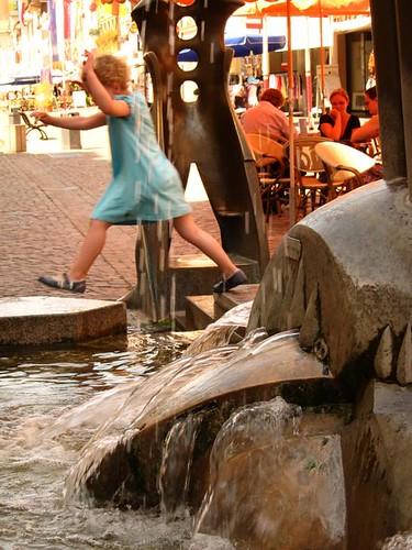 children playing by a fountain in germany waldshut tiengen by Danalynn C