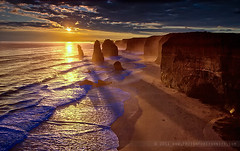 Sunset at the Port Campbell National Park (The Eternity Photography) Tags: ocean longexposure winter sunset shadow sky cloud sun colour tourism beach nature water set clouds reflections spectacular landscape fire evening nationalpark haze waves bright decay au wide australia wideangle victoria filter fallen limestone handheld coastline rays colourful greatoceanroad twelveapostles 1022mm 12apostles apostles cpl santanu weathering circularpolariser gor 2011 superwide portcampbellnationalpark singhray 60d banik canon60d canonefs1022mmf3545usmlens santanubanik thegreatapostles canoneos60d santanubanik        wwwfrozenforeternitycom wwwmomentsofnaturecom reversedgnd theeternityphotography