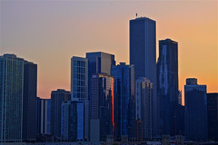A Sliver of Sunshine (AJ Brustein) Tags: blue sunset red sky urban orange lake chicago reflection yellow skyline architecture night canon buildings aj evening pier illinois downtown cityscape loop cluster navy lakeside il clear jungle shore sliver hdr brustein 50d