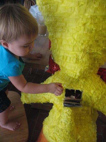 helping to fill the pinata