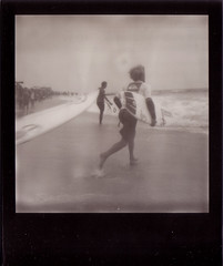 Race for the Waves (timothysschenck) Tags: polaroid longisland longbeach impossible quiksilver quiksilverprony