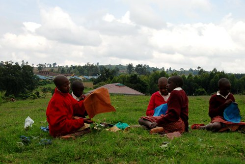 "Kakenya Centre for Excellence girls use their free time to bead (or, ""shona shanga"") their stories on the lawn."