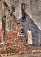 Oakland Cemetery: Old Greenhouse wall (StGrundy) Tags: city atlanta shadow friedhof brick geometric cemetery graveyard wall gardens architecture georgia nikon ruins cementerio historic southern greenhouse cemitrio hdr cimetire 1870 oaklandcemetery fultoncounty 3xp nationalregisterofhistoricplaces photomatix cimiteri tonemapped d80 backyardshots stgrundy artistoftheyearlevel3 artistoftheyearlevel4
