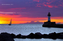 Sunrise Sailing (Boreal Bird) Tags: lighthouse minnesota sailboat sailing northshore dreams imagine duluth lakesuperior morningsky serenitynow dawnsky sunriseclouds lakesunrise lakesuperiorsunrise canalparklighthouse canalparkdawn lakesuperiordawn