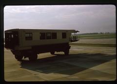 Moon Buggy at Dulles Airport, 1966 (Rob Ketcherside) Tags: tarmac virginia washington airport dulles iad slide 1966 1960s kodachrome moonbuggy mobilelounge