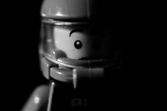 Portrait of an unlikely explorer (Rob_Simpson) Tags: portrait bw white black macro brick nikon lego space name explorer bricks contest sb600 sigma legos minifig f28 150mm d90 pocketwizard