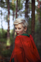 Red (Alexander Kuzmin) Tags: wood red portrait haircut green girl fashion fairytale forest hair scary wolf alone dress darkness availablelight innocent riding short stare hood cloak gaze glance redridinghood  alexanderkuzmin kuzmin