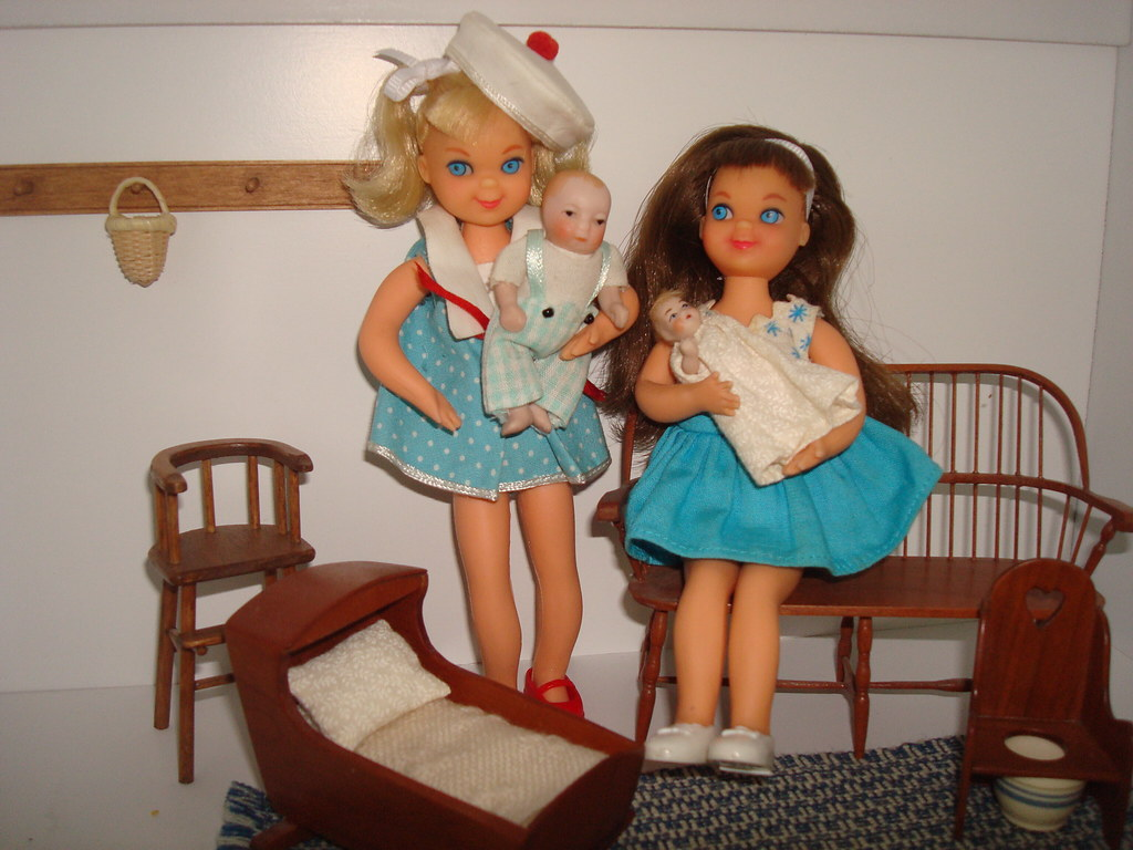 Melody & Tutti playing with baby dolls