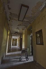 It Moves ... ( MggT BrN ) Tags: newyork abandoned hospital peeling wheelchair urbanexploration urbex nothdr maggotbrain ilovehallways