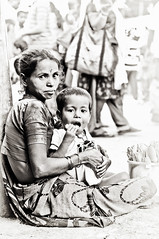 Portrait of a Seller of Lotus Flowers and also a Mother at the Dagdu Seth Ganapati venue in Pune (Anoop Negi) Tags: flowers portrait woman india girl religious photography for photo seth ganesha media child image lotus photos delhi indian religion bangalore creative mother images best celebration indie po maharashtra mumbai anoop indien seller pune inde immersion negi mandai   ndia dagdu photosof   dagdi ezee123  intia  n bestphotographer hindusism   imagesof anoopnegi     jjournalism  ndia n indi