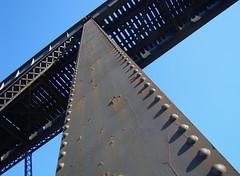simplicity (skylinejunkie) Tags: above railroad trestle bridge blue sky canada black metal iron rivets angles lookingup diagonal slice alberta below lethbridge highlevelbridge
