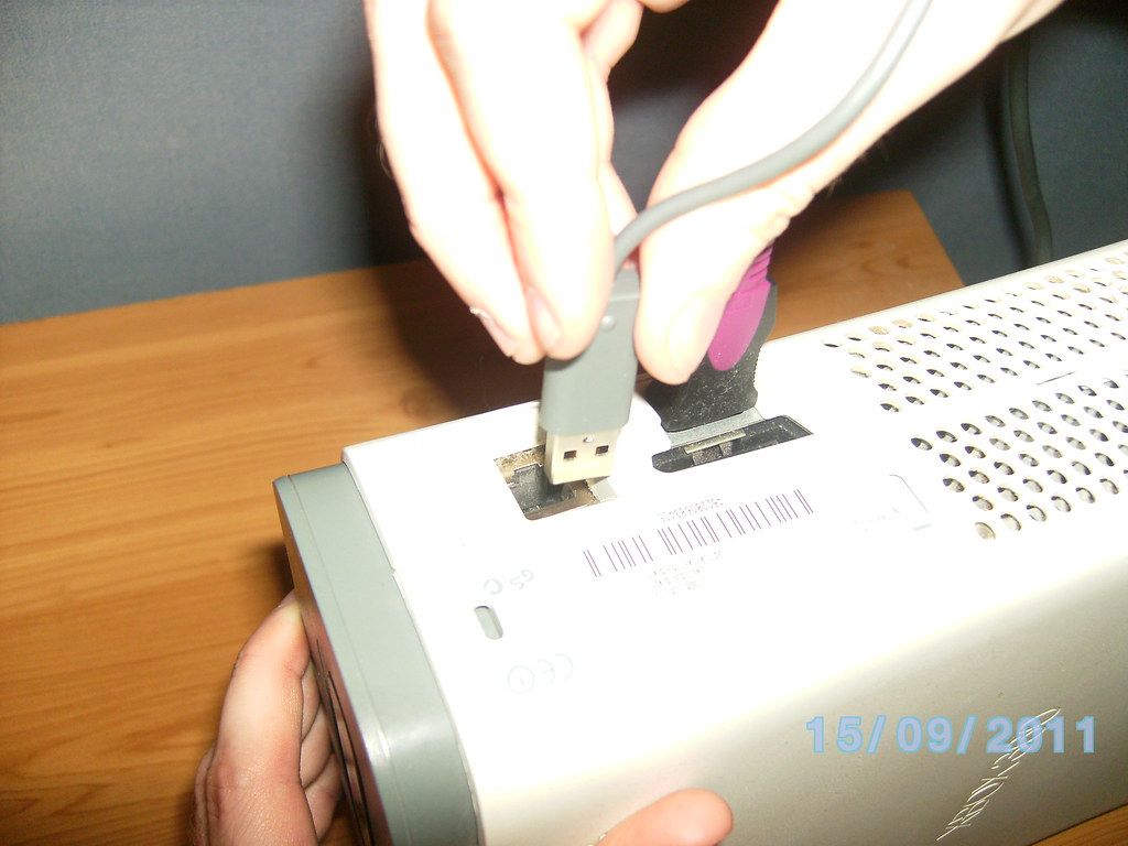 7. Inserting wireless adapter for Xbox live.