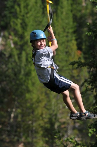 Ethan ziplining at Big Sky MT