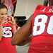 A young Wolfpack fan smiles behind the camera as she takes a photo of a friend and player Jay Smith at Meet the Pack Day (And yes