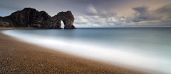 Durdle Door (peterspencer49) Tags: longexposure sunset seascape southwest clouds coast unitedkingdom dusk steps pebbles cliffs dorset limestone moonlight coastline seaview coastalpath westcountry seaarch southwestcoast durdledoor stonearch dorsetcoast southwestcoastalpath seascene oceanveiw limestonearch cliffwalks 5dmkll peterspencer stunningseascape