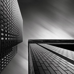 Confrontation (Joel Tjintjelaar) Tags: amsterdam architecture zuidas bwphotography blackandwhitephotography sep2 longexposurephotography nd110 tjintjelaar joeltjintjelaar blackandwhitefineartphotography silverefexpro2 fineartarchitecturalphotography internationalphotographyawards2011 ipa2011architecture1stplacewinner zuidasdistrictamsterdam fineartarchitecture internationalawardwinningphotographer architecturallongexposurephotography blackandwhitefineartarchitecturalphotography