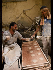 AT THE BAKERY (BoazImages) Tags: smile bread northafrica egypt middleeast culture documentary happiness indoors cairo arab bakery dailylife middleeastern pita islamiccairo anawesomeshot boazimages