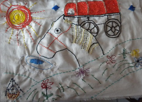 Emilie created this scene of traditional Roma life, complete with a horse and caravan. She incorporated elements from nature, because Roma used to live off the land while still nomadic. The campfire in the bottom left corner is representative of the strong oral traditional of storytelling in the Roma community.