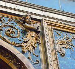 Cherub with camera (elinor04 Thanks for 16,000,000+ views!) Tags: camera old city detail building caf museum architecture hungary gallery district budapest style architectural architect cherub jewish quarter utca bookshop built vi nay s jewishquarter 1894 neorenaissance zsolnay maiman terzvros erzsbetvros nagymez maimanhz houseofhungarianphotography strausz pyrogranite pestbroadway naysstrausz naystrausz