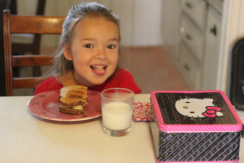 smiling child enjoying breakfast at the kitchen table