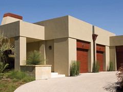 Modern Brown (Behr Paint) Tags: wood red brown architecture modern paint exterior contemporary streamlined walls simple residential stucco woodstain behr neutral flatroof cleanlines exteriorpaint homeexterior premiumplus woodengaragedoors architecturalpaint