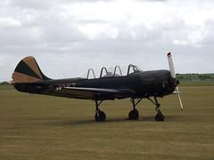 Bacau YAK-52 (Snapshooter46) Tags: airshow duxford cambridgeshire imperialwarmuseum airdisplay may2011 bacauyak52