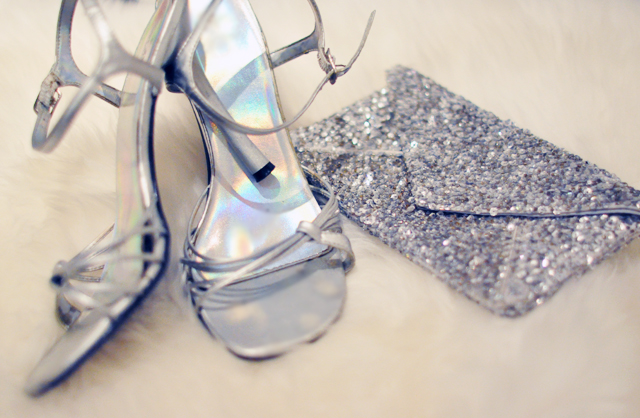 silver heels and sequin clutch bag