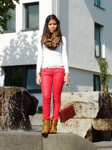 colored jeans with animal print scarf