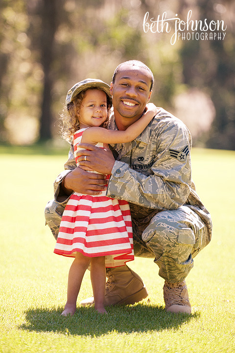 air force dad with his three year old daughter in red and white dress