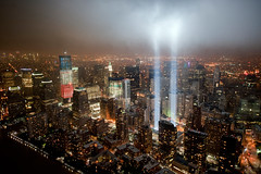 The Freedom Tower with the 9/11 Tribute in Light. (noamgalai) Tags: above city nyc sky ny newyork clouds lights memorial view anniversary 911 helicopter terror wtc tributeinlight 2011 freedomtower tributeinlights noamgalai