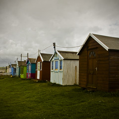 Beach Huts (Again!) (ChrisDale) Tags: beach square coast colours telephone perspective huts devon ho westward bideford