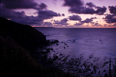 Purple Sunset (ChrisDale) Tags: sunset sea orange silhouette rock clouds coast seaside long exposure purple ho westward
