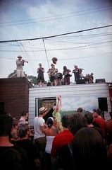 Balkan-Klezmer-Gypsy-Party-Punk Super-Band ( e r e k) Tags: ossington village toronto fedoraupsidedown michaellouisjohnson mj lemonbucketorkestra balkanklezmergypsypartypunksuperband neighbourhood summer block party back parking alleyway alley way laneway garage rooftops dancing food rain downpour vivitarultrawideslim