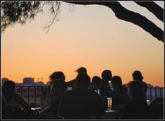 Outdoor bar at sunset, Lisbon. (iMeagain) Tags: sunset people tree portugal beer bar night dark evening europe lisbon alfama