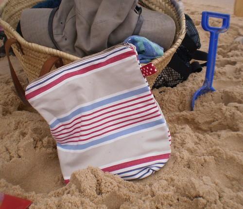 Sponge bag in use for sun creams