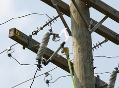Electric Arc as a fuse is reconnected (linuxtuxguy) Tags: trip electric wire power arc utility cable pole cables wires electricity plasma utilitypole breaker fuse blown tripped reconnect