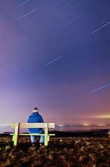40 minutes of patience (Saulius Dainauskas) Tags: ocean longexposure ireland sea sky man galway me night clouds bench stars lights sitting pentax patience startrails lightpollution pentaxart