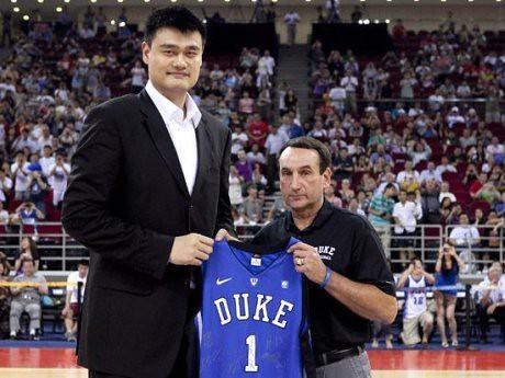 August 22, 2011 - Duke coach Mike Krzyzewski presents Yao Ming with a Duke jersey in Beijing