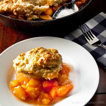 close-up of peach cobbler on plate