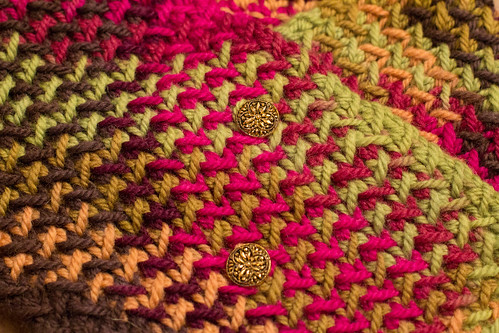 Close up of neckwarmer/button