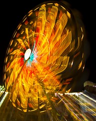 zoomed ferris wheel - explore #99 (Marvin Bredel) Tags: longexposure carnival motion oklahoma night lights lowlight fair explore slowshutter ferriswheel stillwater carnivalride zoomed amusementride paynecounty marvinbredel