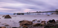Llandudno Pier in the fading light (North Wales) (Anthony Owen-Jones) Tags: ocean longexposure blue light sunset sea summer cloud mist seascape mountains color colour beach water colors lines wales night clouds canon lens landscape eos rebel bay coast landscapes photo interestingness interesting twilight kiss rocks europe long exposure sundown unitedkingdom north gimp explore filter photograph nd getty kit postprocess conwy hoya t3i x5 northwales 600d explored takenwith nd16 canonefs1855mmf3556is clpl rebelt3i kissx5