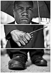 Triptychs of Strangers #18, The Revolutionary Security Guard - London (adde adesokan) Tags: street travel portrait england blackandwhite bw white man black london pen umbrella radio photography shoes triptych securityguard bokeh voigtlander voigtlaender streetphotography olympus security stranger portrt sw mann schwarzweiss revolutionary bricklane weiss schuhe schwarz voigtlnder walkietalkie 25mm triptic ep1 ep2 tryptic triptychs f095 streetphotographer eimsbush m43 triptychon mft funkgert mirrorless triptychons microfourthirds theblackstar epl2 mirrorlesscamera streettogs triptychsofstrangers