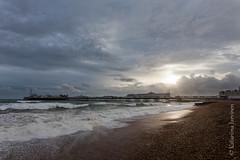 Brighton Palace Pier (Katariina Jrvinen) Tags: sunset sea england beach pier brighton wave pebbles southcoast palacepier