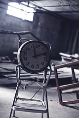 A staring contest I never win (Muse Amour) Tags: dusty abandoned clock broken basement retro stool retroclock vintageclock brokenclock
