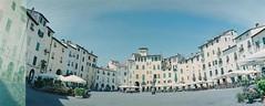 Lucca (saviorjosh) Tags: travel italy panorama holiday film architecture 35mm buildings iso100 lomography italia fuji lucca negative tuscany piazza toscana reala russiancamera panoramiccamera horizonkompakt piazzadellanfiteatro may2011