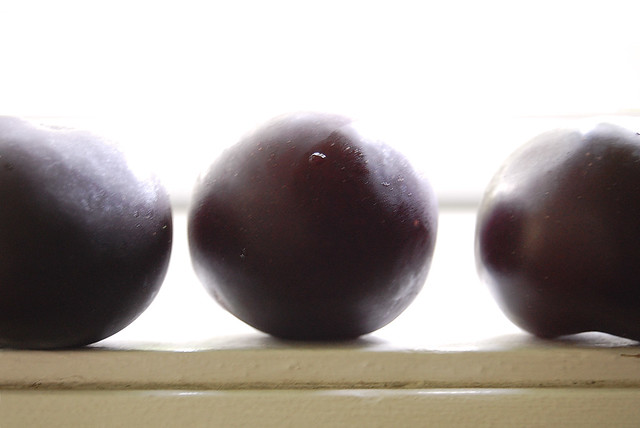 plums on a window sill