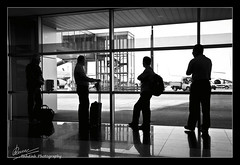 Day 198 - Life has taught us that love does not consist in gazing at each other, but in looking outward together in the same direction ([Linh Dinh]) Tags: street blackandwhite bw white black project photography blackwhite airport nikon days 365 d90