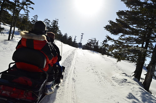 Up on a snow mobile