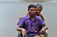 Stranger [56/100]: After the rain (A. adnan) Tags: poverty street portrait smile rain nikon colours dof poor beggar fatherandson bangladesh handicapped drenched dadandson nikkor50mmf14d nikon50mmf14d bangladeshiphotographer 100strangers d7000 peopleofbangladesh aadnan613